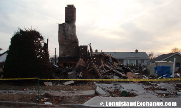 This home in Lindenhurst, N.Y. was burned to the ground with nothing left but its chimney to be seen.