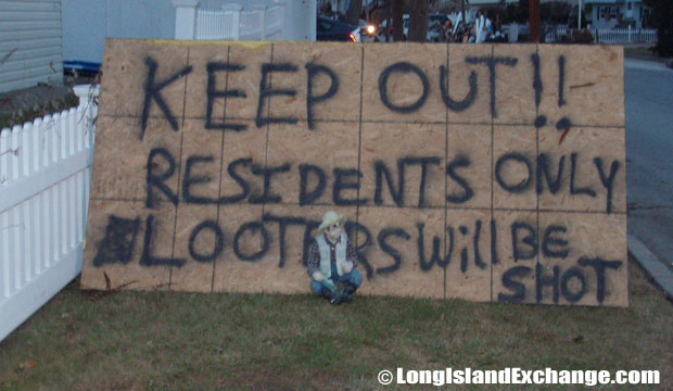 "Another spray-painted warning message threatening thugs and looters to ""Keep Out, Residents Only""."