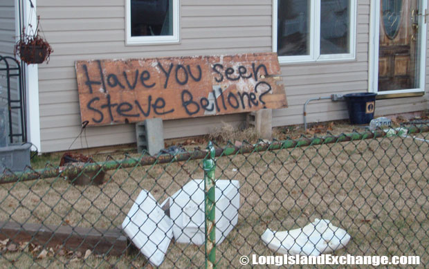 "Frustration is evident in a message spray-painted on fallen wood ""Have you seen [Executive] Steve Bellone?""."