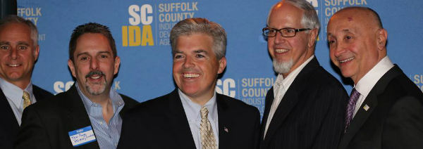 Bellone Praises Agency for Work Boosting New Busin